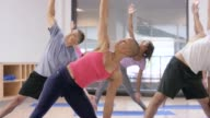 Doing Triangle Position in Yoga Class video