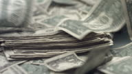 Dollar bills blowing away, slow motion video