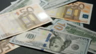 Dollars and euros are falling on the table. video