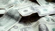 Dollars in pile rotating video