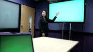 Dolly: Businesswoman presentation using touch-screen, green screen video