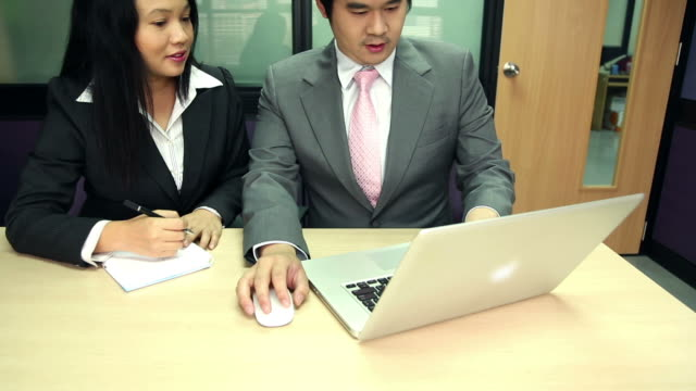 Dolly: Businesswoman Working laptop with manager coaching video