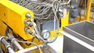 dolly: close-up to opening die on twin  screw extruder video