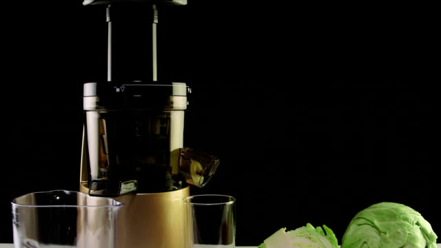 Dolly: Cold press juicer for making freshly squeezed vegetable juice from carrot and cabbage video