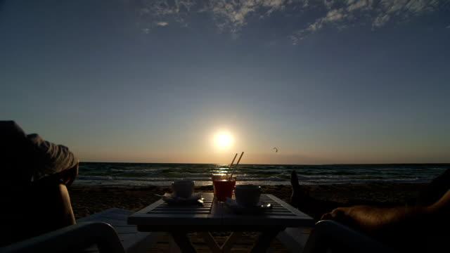 Dolly: Couple enjoying summer beach vacation at sunset video