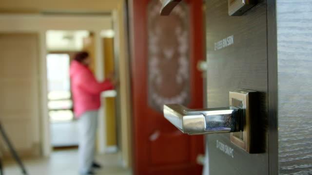 Dolly: Customer chooses new door in the doors store showroom video