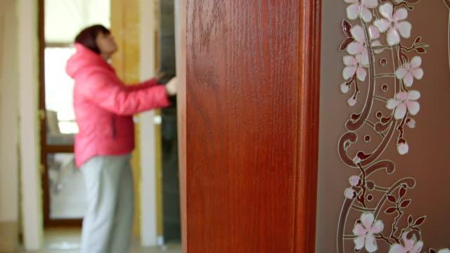 Dolly: Customer looking for new internal door in the doors store showroom video