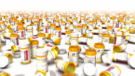 Dolly forward over many Empty Pill Bottles to none video