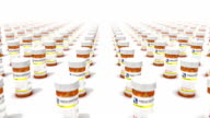 Dolly forward over many Pill Bottles to none video