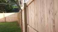 Dolly From New Fence Post to Reveal Fence Rack Focus video