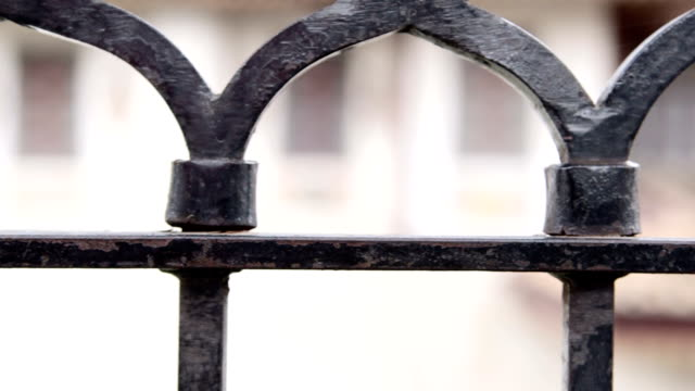 Dolly: Metal fence detail video