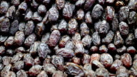 Dolly of dried date fruits in a market video