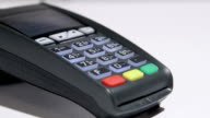 Dolly: Person using credit card payment terminal video
