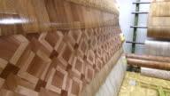 Dolly: Rolls of linoleum in showroom of the flooring warehouse video