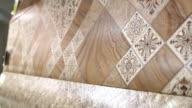Dolly: Samples of linoleum in flooring warehouse showroom video