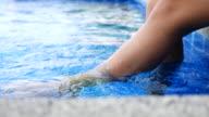 Dolly shot :Beautiful Woman Relaxing pool slde video