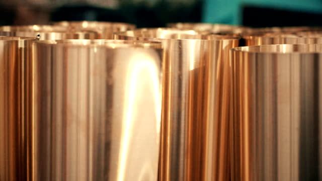 Dolly shot Brass Sheet rolled into a roll for Metalworking Supplies. video