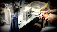 Dolly Shot: Close up workers operate an industrial grinder on a piece of steel. video