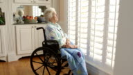 Dolly shot Elderly Person in a wheelchair video