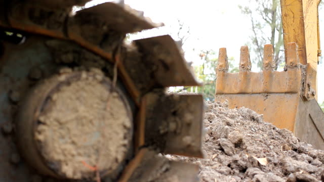 Dolly shot: Excavator in park. video
