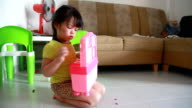 Dolly shot girl is playing dough with toy in her house video