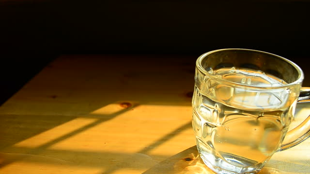 Dolly Shot: Glass of Water on the Table video
