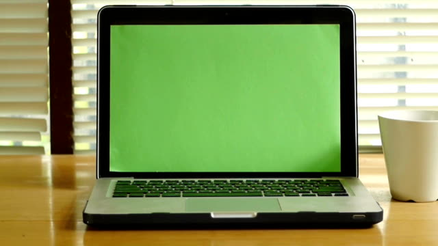 Dolly shot - Laptop computer notebook with green screen monitor video