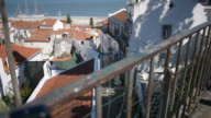 Dolly shot of a narrow street in Lisbon over a handrail video