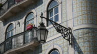 Dolly shot of a typical portuguese facade and street lamp video