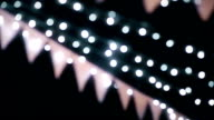 MS Dolly shot of Beautiful Wedding bunting with lights Bokeh by film grain style. video