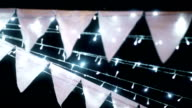 CU Dolly shot of Beautiful Wedding bunting with lights Bokeh by film grain style. video