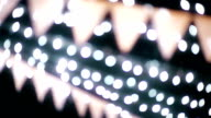 CU Dolly shot of Beautiful Wedding bunting with lights Bokeh video
