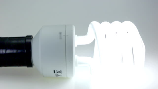 Dolly shot of CFL bulb, closeup video