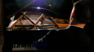 Dolly Shot of Male Piano Solo Playing Beautifully on Stage with Grand Piano video