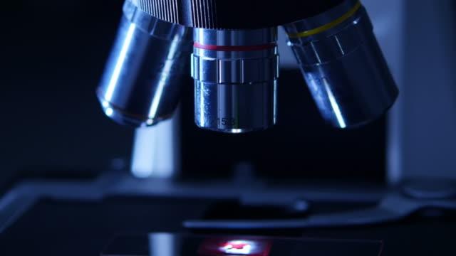 Dolly Shot of Microscope in Dark video