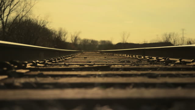 Dolly shot of Railroad Tracks with Gold Sky video