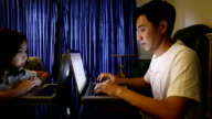 Dolly shot: Two College students studying with laptop together video