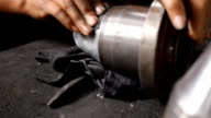 Dolly Shot: Worker polishing metal. video