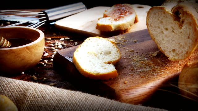 Dolly shot:Bread on wooden table, Color grading. video