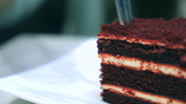 Dolly Shot:Chocolate cake with serving and cutting video