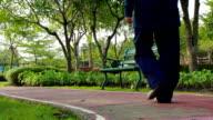 Dolly Shot:Girl walk in park video
