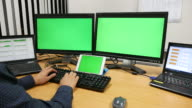 Dolly shot:Laptop and monitor Display with a Green Screen video