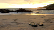 Dolly shot:Sandals at the sunset beach video