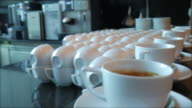 Dolly shot:Serving coffee and tea at bar video
