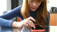 Dolly Shot:Youngwoman playing mobile phone video