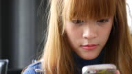 Dolly Shot:Youngwoman use mobile phone video