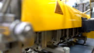 dolly: side view of twin screw extruder video