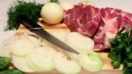 Dolly: Sliced fresh pork meat and vegetables video