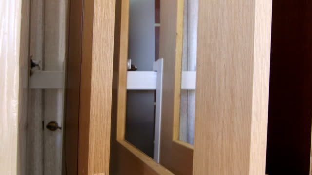 Dolly: Variety of wooden interior doors in the door store showroom video