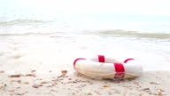 HD Dolly:Lifebuoy on the beach. video